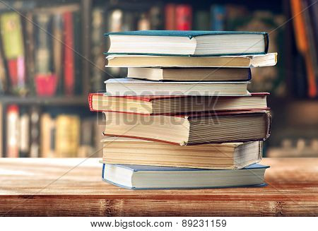A Stack Of Book On The Shelf