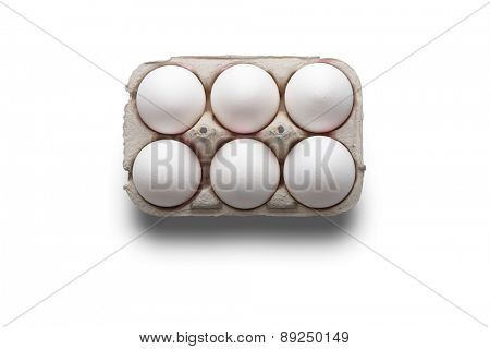 High angle studio shot of six white eggs in a box isolated on white background