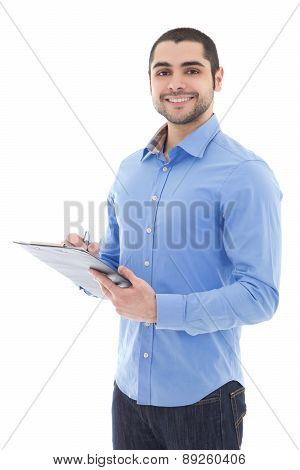 Young Arabic Man Writing Something On Clipboard Isolated On White