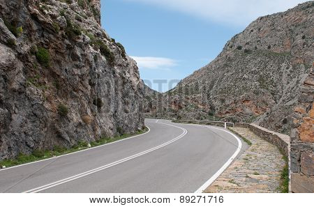 Empty Rural Road Passing Via A Beautiful  Gorge