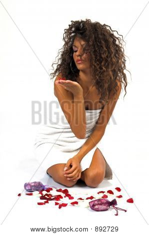 Beautiful Young Woman Blowing Flowers