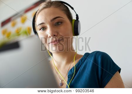 Woman With Green Earphones Listens Podcast Music On Tablet