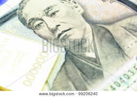 Japanese One Thousand Yen Note, A Macro Close-up With Gold Bullion.