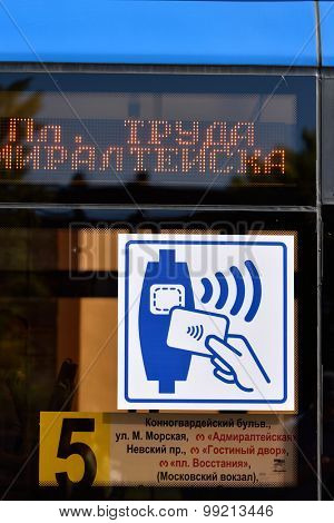 ST. PETERSBURG, RUSSIA - AUGUST 17, 2015: Sign of contactless ticketing system on the trolleybus. The system supporting MasterCard PayPass was demonstrated to press in 3rd trolleybus depot