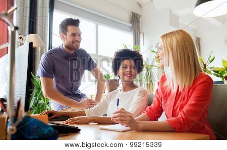 business, startup and people concept - happy creative team talking in office