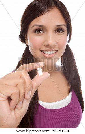 Hispanic Teen Girl With Medicine Pill