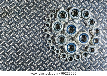 Central Spiral Arrangement Of Nylon Lock Nuts.