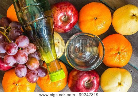 Bottle Of Juice On  Fruits.