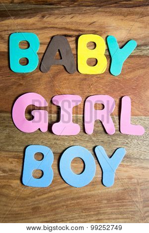 colorful letters - the words baby girl and boy