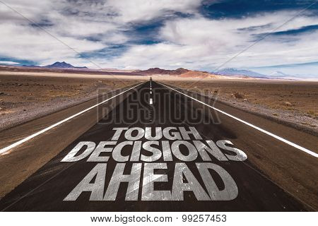 Tough Decisions Ahead written on desert road poster