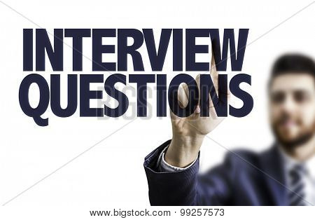 Business man pointing the text: Interview Questions
