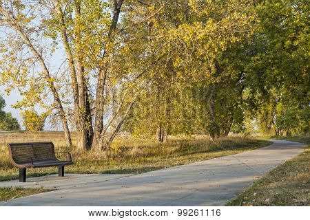 bench and recreational biking trail in Boyd Lake State Park near Loveland, Colorado, fall scenery