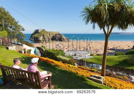 Beautiful weather and summer sunshine drew visitors to Tenby castle beach South Wales