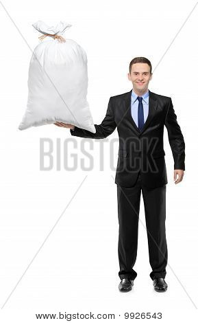Full Length Portrait Of A Happy Businessman Holding A Money Bag