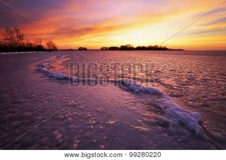 Beautiful winter landscape with sunset fiery sky.