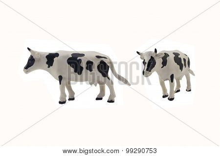 Isolated cow toy photo.