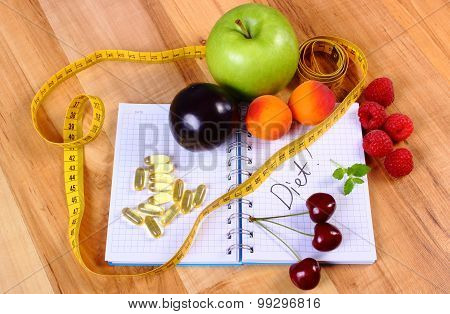 Fresh fruits tape measure and tablets supplements on notebook for writing notes choice between healthy eating and slimming pills poster