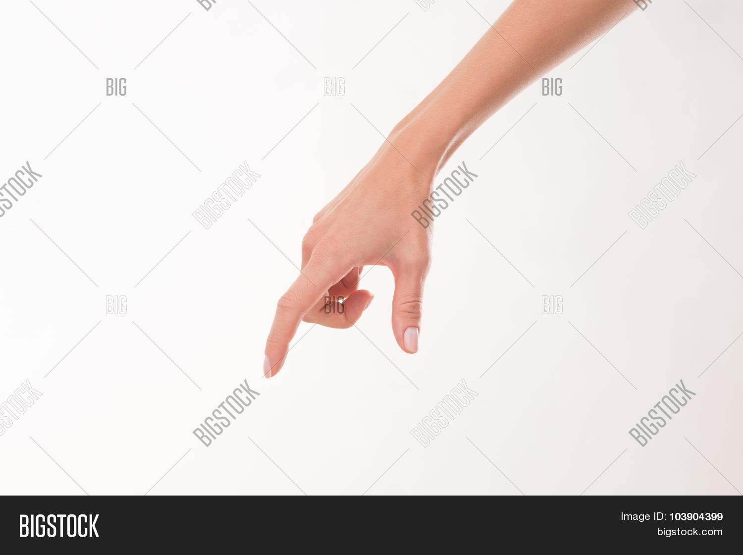 d5cd9b97ef3b0 Two woman's fingers holding something over white background. Woman's hand  showing its skincare.