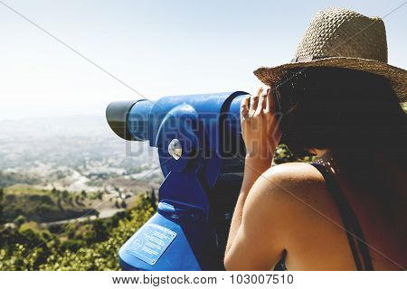 Woman Looking At Landscape Through A Telescope. Vintage Tone.