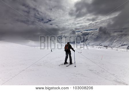 Skiers On Ski Slope Before Storm