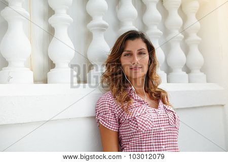 Caucasian Woman Relaxing While Listening To Music