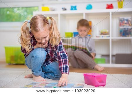Cute Little Girl Play Game, Boy Read Book