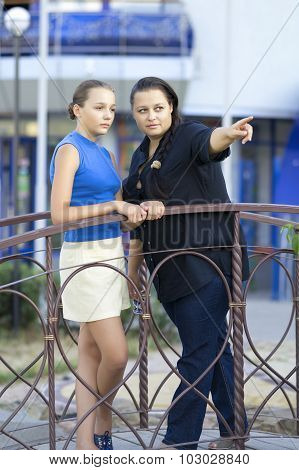 The Woman And The Teenager On The Bridge.