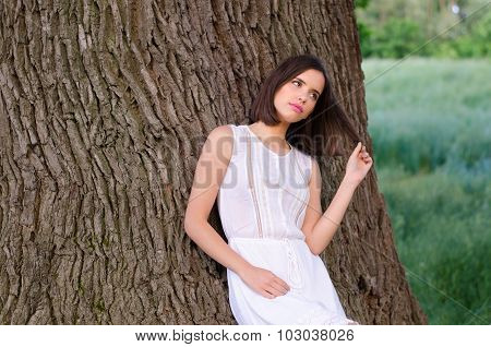 Portrait Of The Beautiful Girl In The Woods In Spring