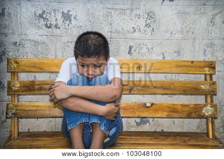 Asian child scared and alone in the park