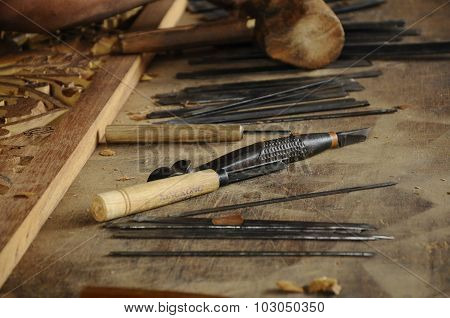 Wood carving tools at craftsman workshop