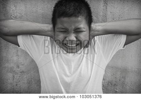An Asian boy is seen raising his hands and covering his ears to try and block out the abuse he is suffering, poster