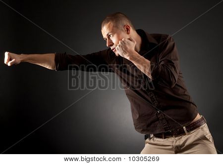 A Man In Fight Action