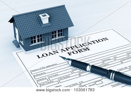 Loan Application Form With House And Pen