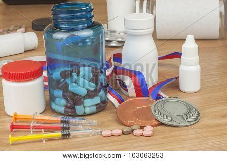 Doping in sport. Abuse of anabolic steroids for sports. Anabolic steroids spilled on a wooden table.