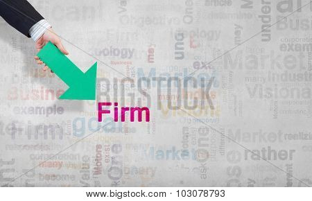 Businessman hand pointing with arrow on word FIRM poster