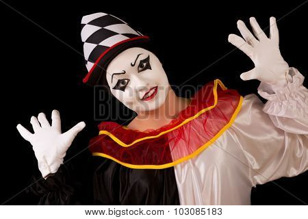 Isolated portrait of a funny happy Pierrot clown