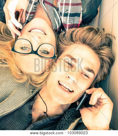 Couple In Love Having Fun With Smartphones - Close Up Of Happy Hipster Lovers - Youth Tech Concept