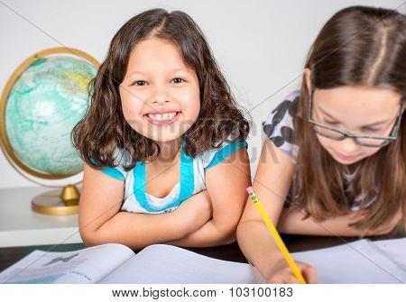 Two little girls doing their school homework