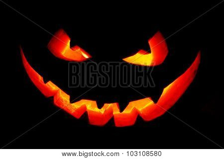 Funny Halloween Jack O' Lantern pumpkin smile isolated on black background