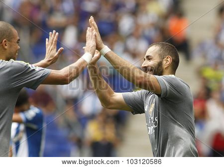 BARCELONA - SEPT, 12: Karim Benzama of Real Madrid celebrating a goal during a Spanish League match against RCD Espanyol at the Power8 stadium on September 12 2015 in Barcelona Spain