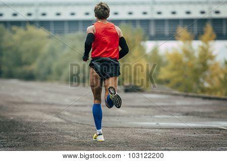 young runner running across street