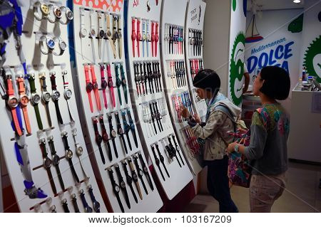 ROME, ITALY - AUGUST 16, 2015: Swatch store interior. Swatch SA design, manufacture, distribute and service wristwatches sold under the 'Swatch' and 'Flik Flak' brands