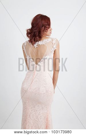 Back Half Portrait Of A Beautiful Girl In A Light Pink Dress Isolated On Overwhite Background