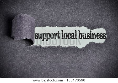 Support Local Business Word Under Torn Black Sugar Paper