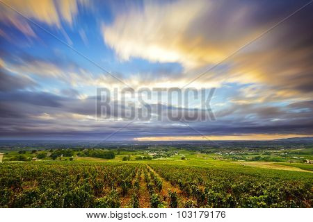 Clouds In Long Exposure At Sunrise Time Over Vineyards Of Beaujolais, France