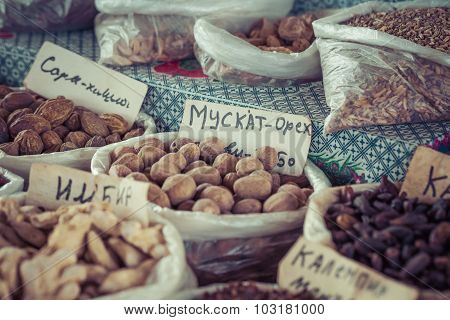 Beautiful vivid oriental market with bags full of various spices in Osh Kyrgyzstan. poster