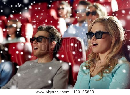 cinema, technology, entertainment and people concept - young woman in 3d glasses watching horror or thriller movie with friends in theater with snowflakes