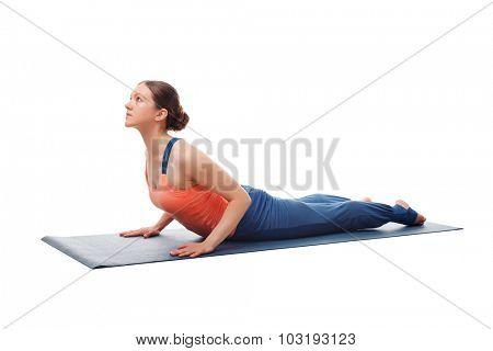 Beautiful sporty fit yogini woman practices yoga asana bhujangasana - cobra pose beginner variation isolated on white background