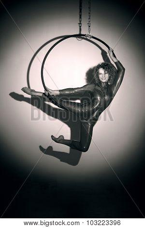 Sporty girl posing with aerial hoop