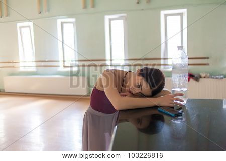 Weary Classic Ballet Dancer In Rehearsal Room Background